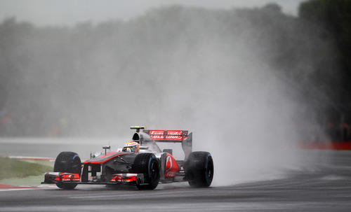Britain's Lewis Hamilton driving a McLaren-Mercedes Formula 1 car during qualifying at the Silverstone circuit, England, Saturday, July 7, 2012. The Formula 1 teams make preparations ahead of the British Grand Prix at Silverstone circuit on Sunday. (AP Photo/Tim Hales)