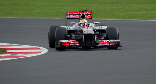 Britain's Lewis Hamilton driving a McLaren-Mercedes Formula 1 car takes Luffield corner during practice at the Silverstone circuit, England, Saturday, July 7, 2012. The Formula 1 teams make preparations ahead of the British Grand Prix at Silverstone circuit on Sunday. (AP Photo/Tom Hevezi)