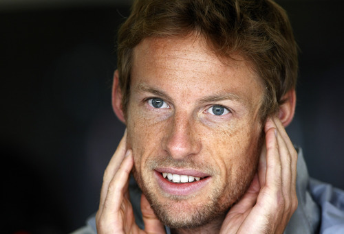 Britain's Jenson Button before practice at the Silverstone circuit, England, Saturday, July 7, 2012. The Formula 1 teams make preparations ahead of the British Grand Prix at Silverstone circuit on Sunday. (AP Photo/Tim Hales)