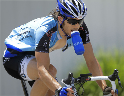 Nick Ramirez holds a water bottle in his mouth to stay hydrated while competing in a bike race in Morton, Ill. on Saturday, July 7, 2012 during a record breaking heat wave affecting half of the country. The heat sent temperatures soaring over 100 degrees in several cities, including a record 105 in Washington, St. Louis (106), and Indianapolis (104). (AP Photo/Seth Perlman)
