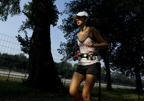 A runner uses shade from the trees to cool down her temperature at the National Mall in Washington Saturday, July 7, 2012.  The heat gripping much of the country is set to peak Saturday in many places, including some Northeast cities, where temperatures close to or surpassing 100 degrees are expected. (AP Photo/Manuel Balce Ceneta)