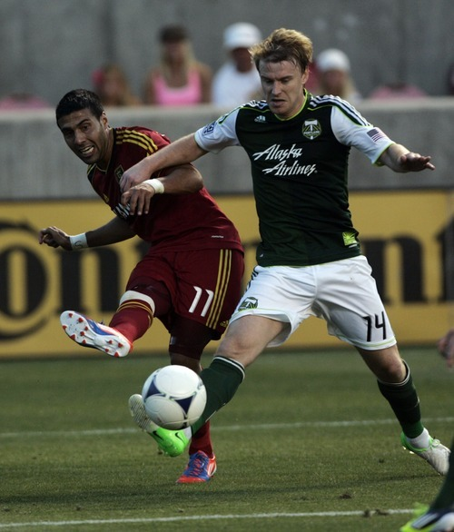 Kim Raff | The Salt Lake Tribune Real Salt Lake player Javier Morales passes the ball in front of the goal as Portland Timbers' player Steven Smith defends during a game at Rio Tinto Stadium in Sandy, Utah on July 7, 2012.
