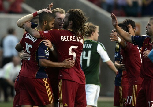 Kim Raff | The Salt Lake Tribune Real Salt Lake player Alvaro Saborio celebrates with his teammates after scoring a goal on the Portland Timbers at Rio Tinto Stadium in Sandy, Utah on July 7, 2012.  Saborio ended up scoring a hat trick leading Real to win the game 3-0.
