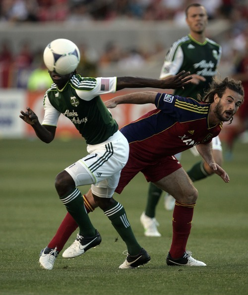 Kim Raff | The Salt Lake Tribune Real Salt Lake player Kyle Beckerman and Portland Timbers' player Diego Chara chase a loose ball at Rio Tinto Stadium in Sandy, Utah on July 7, 2012.