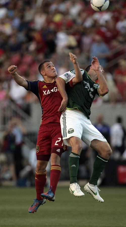 Kim Raff | The Salt Lake Tribune Real Salt Lake player Luis Gil and Portland Timbers player Jack Jewsbury battle for a head ball at Rio Tinto Stadium in Sandy, Utah on July 7, 2012.  Real went on to win the game 3-0.