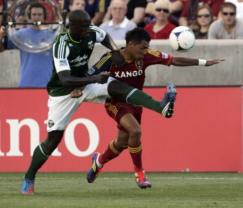 Kim Raff | The Salt Lake Tribune Real Salt Lake player (right) Paulo Junior and Portland Timbers player Mamdou Danso battle for the ball during a game at Rio Tinto Stadium in Sandy, Utah on July 7, 2012. Real went on to win the game 3-0.