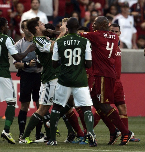 Kim Raff | The Salt Lake Tribune Real Salt Lake player (right) Jamison Olave fights with Portland Timbers player David Horst at Rio Tinto Stadium in Sandy, Utah on July 7, 2012.  Real went on to win the game 3-0.