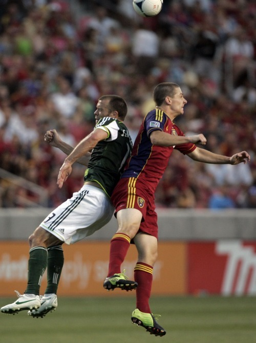Kim Raff | The Salt Lake Tribune (right) Real Salt Lake player Will Johnson and Portland Timbers player  Jack Jewsbury battle for a head ball during a game at Rio Tinto Stadium in Sandy, Utah on July 7, 2012.  Real went on to win the game 3-0.