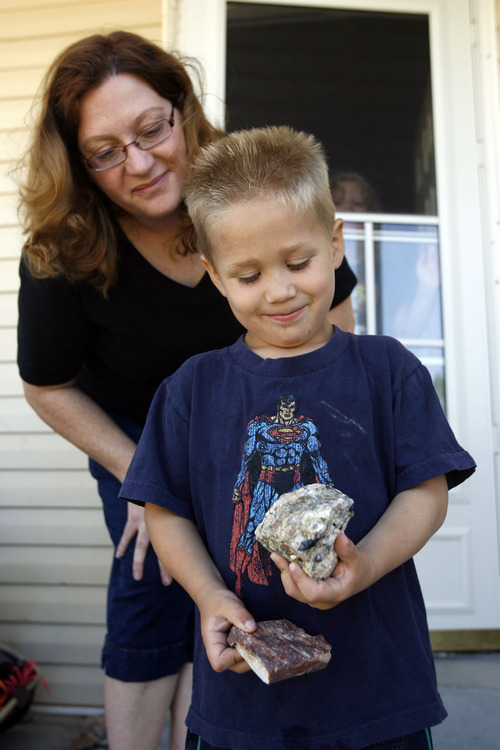 Francisco Kjolseth  |  The Salt Lake Tribune Maia Caldwell of Tooele, spends time with her son Seth, 4, as he shows off his fascination with rocks during a recent visit on Friday, July 7, 2012. State officials are trying to increase awareness of the Utah Newborn Safe Haven law, which allows moms to anonymously give up babies at hospitals. Caldwell received Seth thanks to the law when he was only a few weeks old. Friday, July 6, 2012.
