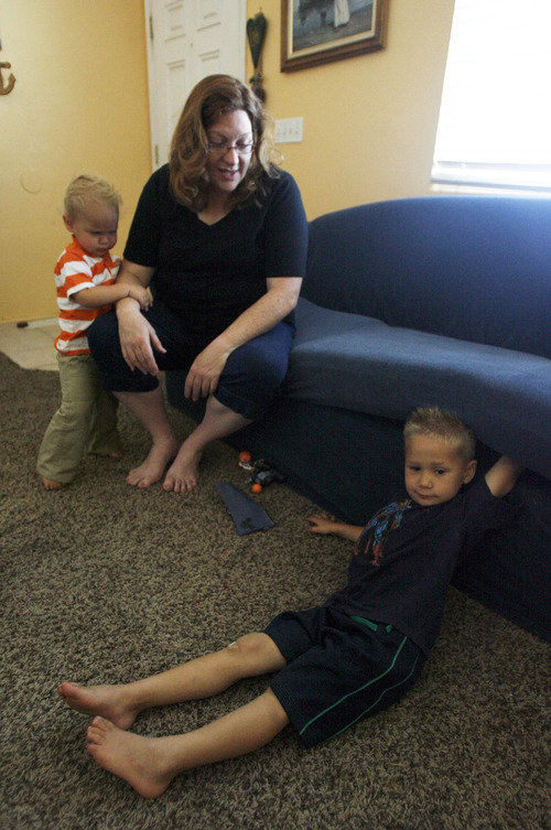 Francisco Kjolseth  |  The Salt Lake Tribune Maia Caldwell of Tooele, spends time with her sons Julan, 1, and Seth, 4, as as the focus shifts towards lunch plans during a recent visit on Friday, July 7, 2012. State officials are trying to increase awareness of the Utah Newborn Safe Haven law, which allows moms to anonymously give up babies at hospitals. Caldwell received Seth thanks to the law when he was only a few weeks old.