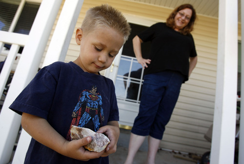 Francisco Kjolseth  |  The Salt Lake Tribune Maia Caldwell of Tooele, spends time with her son Seth, 4, as he shows off his fascination with rocks during a recent visit on Friday, July 7, 2012. State officials are trying to increase awareness of the Utah Newborn Safe Haven law, which allows moms to anonymously give up babies at hospitals. Caldwell received Seth thanks to the law when he was only a few weeks old.