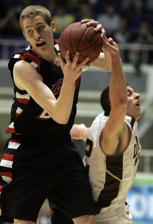 Jim Urquhart  |  The Salt Lake Tribune Alta's Kyle Davis comes up with a loose ball past Davis' Kyle Smith during 5a boys high school championship basketball  Saturday, March 6 2010 at Dee Events Center on the campus of Weber State University in Ogden. Alta High School defeated Davis High School to claim the 5A title. 3/6/10