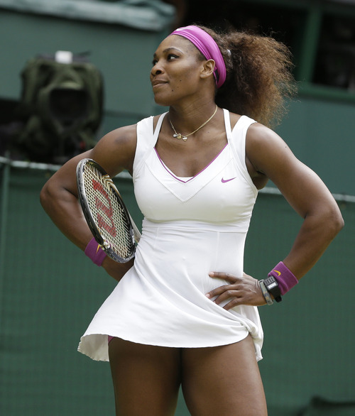 Serena Williams of the United States challenges the linesman during her women's final match against Agnieszka Radwanska of Poland at the All England Lawn Tennis Championships at Wimbledon, England, Saturday, July 7, 2012. (AP Photo/Kirsty Wigglesworth)