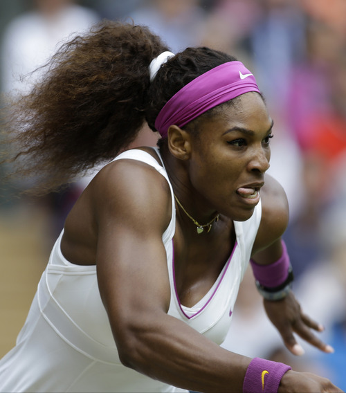 Serena Williams of the United States runs for a shot to Agnieszka Radwanska of Poland during the women's final match at the All England Lawn Tennis Championships at Wimbledon, England, Saturday, July 7, 2012. (AP Photo/Alastair Grant)