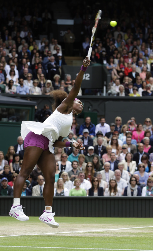 Serena Williams of the United States serves to Agnieszka Radwanska of Poland during the women's final match at the All England Lawn Tennis Championships at Wimbledon, England, Saturday, July 7, 2012. (AP Photo/Kirsty Wigglesworth)