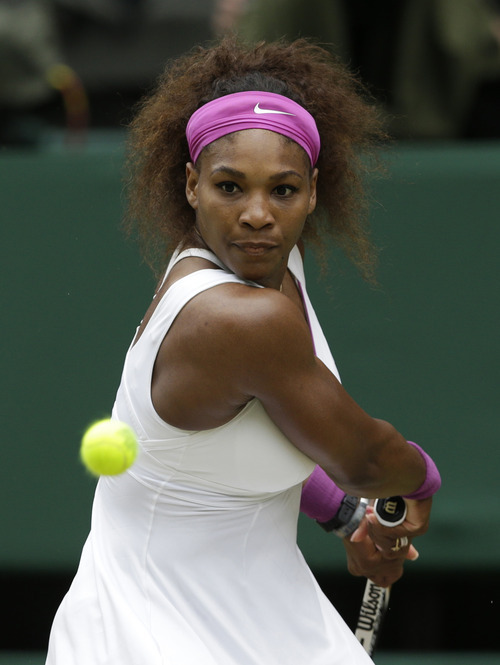Serena Williams of the United States plays a shot to Agnieszka Radwanska of Poland during the women's final match at the All England Lawn Tennis Championships at Wimbledon, England, Saturday, July 7, 2012. (AP Photo/Kirsty Wigglesworth)