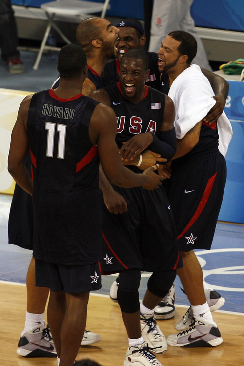 Tribune file photo Team USA celebrates after winning the gold medal at the Beijing 2008 Olympic Games.