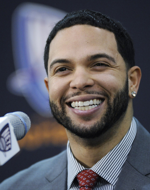 New Jersey Nets Deron Williams smiles as he talks to the media at a news conference Thursday, Feb. 24, 2011 in East Rutherford, N.J. (AP Photo/Bill Kostroun)