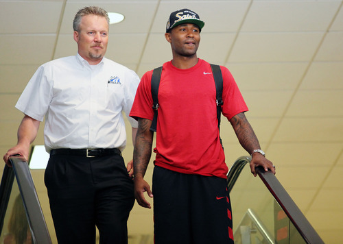 Lennie Mahler  |  The Salt Lake Tribune Jazz CEO Greg Miller and point guard Mo Williams greet the media for Williams' arrival at the Salt Lake City International Airport on Monday, July 2, 2012.