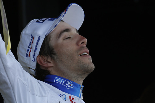 Stage winner Thibaut Pinot of France closes his eyes on the podium of the 8th stage of the Tour de France cycling race over 157.5 kilometers (98.5 miles) with start in Belfort, France, and finish in Porrentruy, Switzerland, Sunday July 8, 2012. (AP Photo/Laurent Rebours)