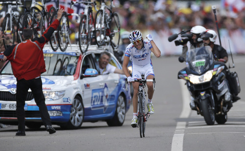 Team director Marc Madiot, left, celebrates in his car as Thibaut Pinot of France crosses the finish line to win the 8th stage of the Tour de France cycling race over 157.5 kilometers (98.5 miles) with start in Belfort, France, and finish in Porrentruy, Switzerland, Sunday July 8, 2012. (AP Photo/Laurent Rebours)