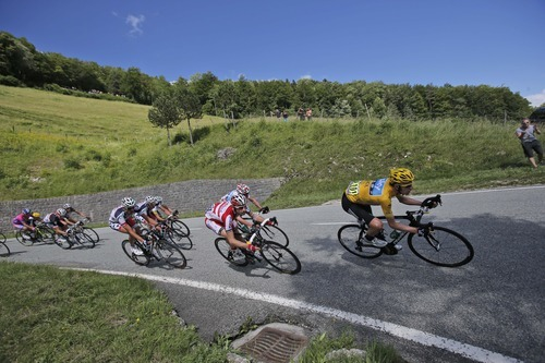 From right, Bradley Wiggins of Britain, wearing the overall leader's yellow jersey, Denis Menchov of Russia, Christopher Froome of Britain, Jelle Vanendert of Belgium, and Jurgen Van Den Broeck of Belgium, speed down Cote de Caquerelle during the 8th stage of the Tour de France cycling race over 157.5 kilometers (98.5 miles) with start in Belfort, France, and finish in Porrentruy, Switzerland, Sunday July 8, 2012. (AP Photo/Christophe Ena)