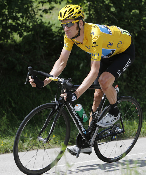Bradley Wiggins of Britain, wearing the overall leader's yellow jersey, speeds down Cote de Maison Rouge during the 8th stage of the Tour de France cycling race over 157.5 kilometers (98.5 miles) with start in Belfort, France, and finish in Porrentruy, Switzerland, Sunday July 8, 2012. (AP Photo/Laurent Cipriani)