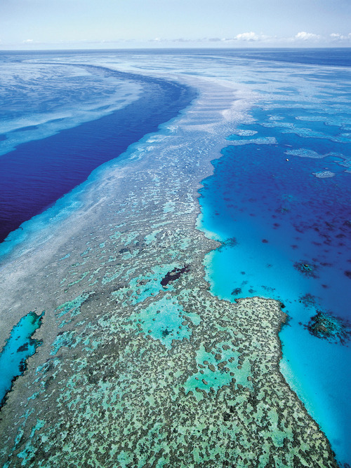 FILE - In this Sept. 2001 file photo provided by provided by Queensland Tourism, an aerial view shows the Great Barrier Reef off Australia's Queensland state. Ocean acidification has emerged as one of the biggest threats to coral reefs across the world, acting as the