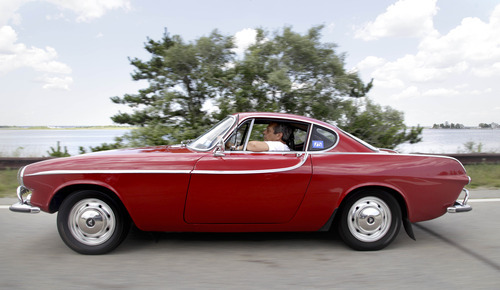 Irv Gordon drives his Volvo P1800 in Babylon, N.Y., Monday, July 2, 2012. Gordon's car already holds the world record for the highest recorded milage on a car and he is less than 40,000 miles away from passing three million miles on the Volvo.  (AP Photo/Seth Wenig)