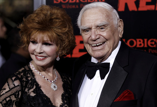 FILE - In this Oct. 11, 2010, file photo, cast member Ernest Borgnine, right, and his wife, Tova, arrive at a special screening of the film