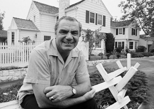 FILE - In this July 1, 1969, file photo, actor Ernest Borgnine poses  in front of his home in the mountains above Hollywood, Calif.  A spokesman said Sunday, July 8, 2012, that Borgnine has died at the age of 95. (AP Photo/George Brich, File)