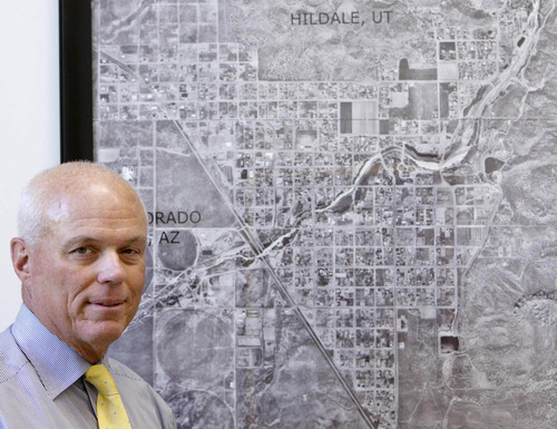 Tribune file photo Special fiduciary Bruce R. Wisan in his office with an aerial map of Hildale and Colorado City.