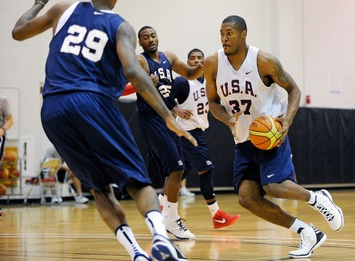 Derrick Favors, right, of the 2012 USA Men's Select Team drives for the basket during practice at the Mendenhall Center on Monday, July 9, 2012 in Las Vegas. (Photo by David Becker)