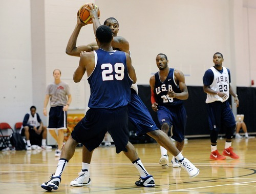Derrick Favors of the 2012 USA Men's Select Team looks for an open man with Paul George defending during at the Mendenhall Center on Monday, July 9, 2012 in Las Vegas. (Photo by David Becker)