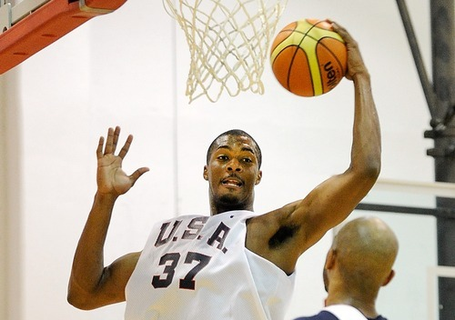 Derrick Favors of the 2012 USA Men's Select Team grabs a rebound against Taj Gibson during practice at the Mendenhall Center on Monday, July 9, 2012 in Las Vegas. (Photo by David Becker)