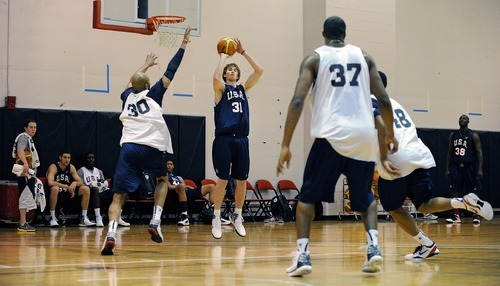 Gordon Hayward, center, of the 2012 USA Men's Select Team goes for a jump shot during practice at the Mendenhall Center on Monday, July 9, 2012 in Las Vegas. (Photo by David Becker)