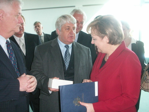 Courtesy photo Rep. Rob Bishop exchanges greetings with German Chancellor Angela Merkel.
