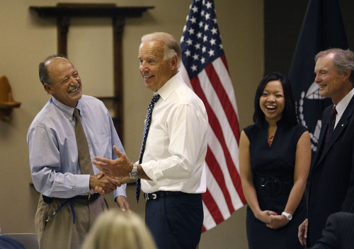 Vice President Joe Biden, center, meets with veterans and employees at the U.S. Vets Career Center in Las Vegas Tuesday, July 10, 2012. (AP Photo/Las Vegas Review-Journal, John Locher)