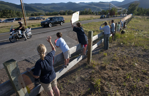 Steve Griffin | The Salt Lake Tribune   Courtney Opdyke, and her sons, Sam, 6, and Alex, 10, wave at the Vice President of the United States,  Joe Biden, as he passes them on  the Old Ranch Road in Park City, Utah Tuesday July 10, 2012. Bidden was speaking at a fundraiser at the Park City home of John and Kristi Cumming.