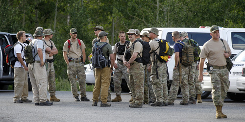 Al Hartmann     The Salt Lake Tribune   Family members of Oknom Shim Han wait at command center at White Pine trailhead in Little Cottonwood Canyon on Wednesday, July 11 as Salt Lake County Unified Police Department search and rescue and SWAT team members gather to resume their search. Han was found alive and well later Wednesday.