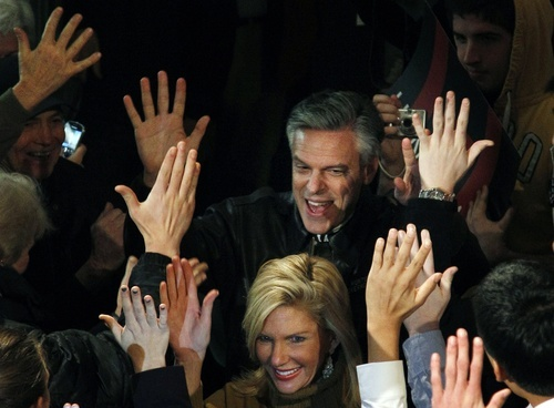 Republican presidential candidate former Utah Gov. Jon Huntsman follows his wife, Mary Kaye, as they enter a campaign rally in Exeter, N.H., Monday, Jan. 9, 2012. (AP Photo/Elise Amendola)