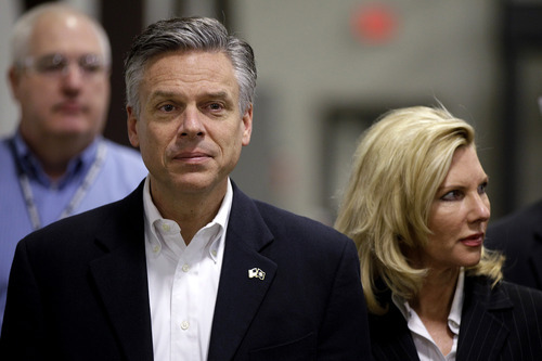 Former Republican presidential candidate, former Utah Gov. Jon Huntsman and his wife Mary Kaye tour the Goss International plant in Durham, N.H., Thursday, Jan. 5, 2012. (AP Photo/Stephan Savoia)