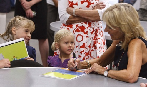 Leah Hogsten  |  The Salt Lake Tribune Left to right, Sara Love, 5, and her sister Kylie, 3, get their journals signed by Jill Biden, wife of U.S. Vice President Joe Biden. She met with Utah National Guard soldiers and their families at the Utah Air Guard  Tuesday in Salt Lake City. She's hoping to raise awareness for Joining Forces, a national initiative to support service members and their families.