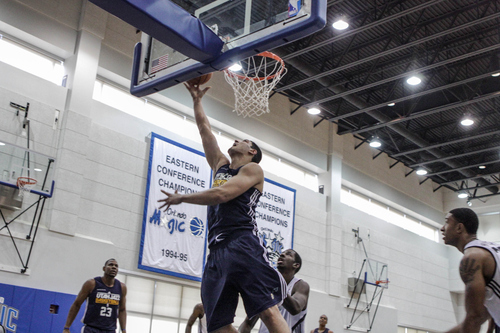 Utah center Enes Kanter (0) goes up to the basket during third quarter action of an Orlando pro summer league game against the Orlando Magic at Amway Center in Orlando, Fla. on Wednesday July 11, 2012. (Joshua C. Cruey/Orlando Sentinel)