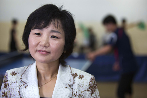 In this June 13, 2012 photo, North Korean Li Pun Hui speaks to media at the Taedonggong Cultural Center for the Disabled in Pyongyang, North Korea. Putting aside politics, the intensely competitive Li paired up with her arch rival, South Korean star Hyun Jung-hwa, in 1991 as part of the first