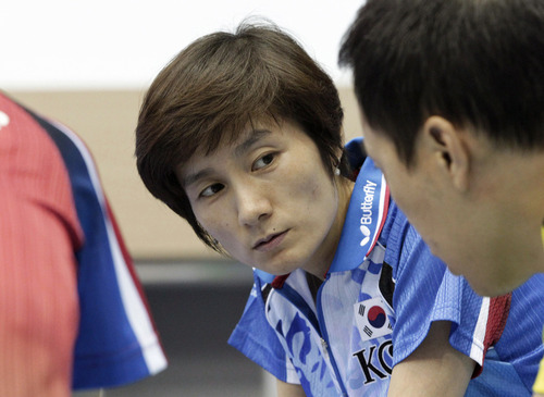 In this Wednesday, June 27, 2012 photo, Hyun Jung-hwa, the head coach of South Korea's Olympic women table tennis team, left, talks with Yoo Nam-kyu, Olympic men's table tennis team player, at the National Training Center in Seoul, South Korea. South Korean table tennis star Hyun teamed up with North Korean Li Pun Hui in 1991 as part of the first