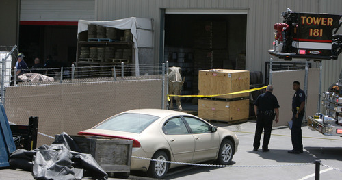 Steve Griffin | The Salt Lake Tribune   Authorities investigate an explosion at Adonis Bronze at 450 S. Alpine Highway in Alpine, Utah Thursday July 12, 2012.  The explosion killed a employee of the business.