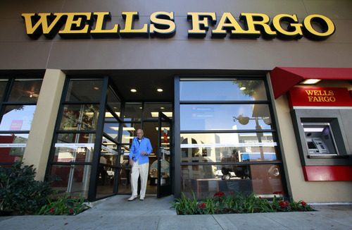 (AP Photo/Reed Saxon, file) The complaint said Wells Fargo was aware the fees and interest rates it was charging discriminated against minority borrowers but that it failed to stop the predatory lending practices.