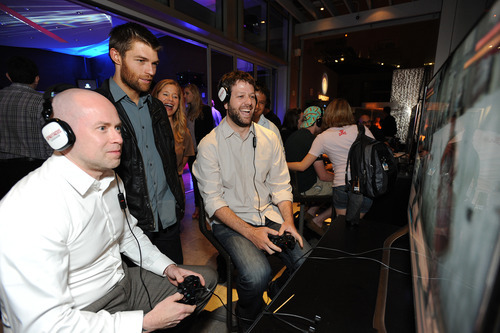 Steven S. DeKnight and Liam McIntyre play Spartacus Legends at the Ubisoft Comic-Con 2012 video game showcase at The Ultimate Skybox at Diamond View Tower on Thursday, July 12, 2012 in San Diego, CA.  (Photo by Jordan Strauss/Invision for Ubisoft/AP Images)