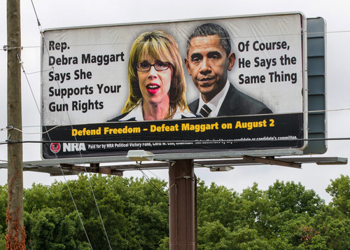 This July 12, 2012, photo shows a National Rifle Association billboard in Hendersonville, Tenn., attacking Tennessee House Republican Caucus Chairwoman Debra Maggart. The gun rights group has had a falling out with Republican lawmakers in Tennessee over a bill seeking to guarantee workers the right to store their guns in their cars while at work.  (AP Photo/Erik Schelzig)